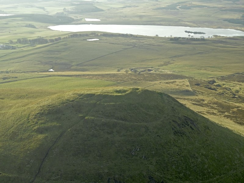 Oblique aerial view centred on the remains of the fort, taken from the NE.