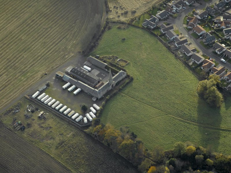 Oblique aerial view centred on the steading, taken from the N.