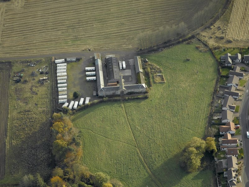 Oblique aerial view centred on the steading, taken from the NW.