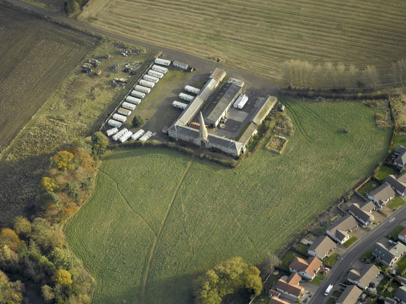 Oblique aerial view centred on the steading, taken from the WNW.