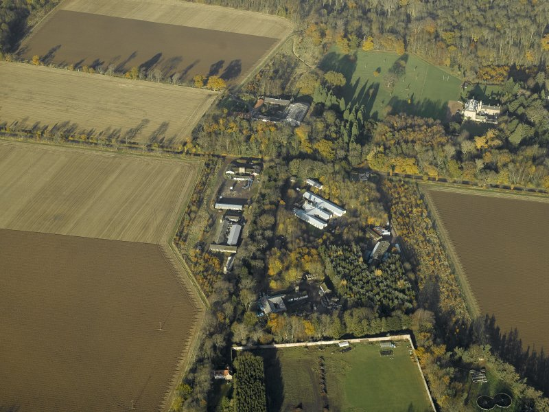 Oblique aerial view centred on the recreation area of the airfield with Gilmerton House adjacent, taken from the S.