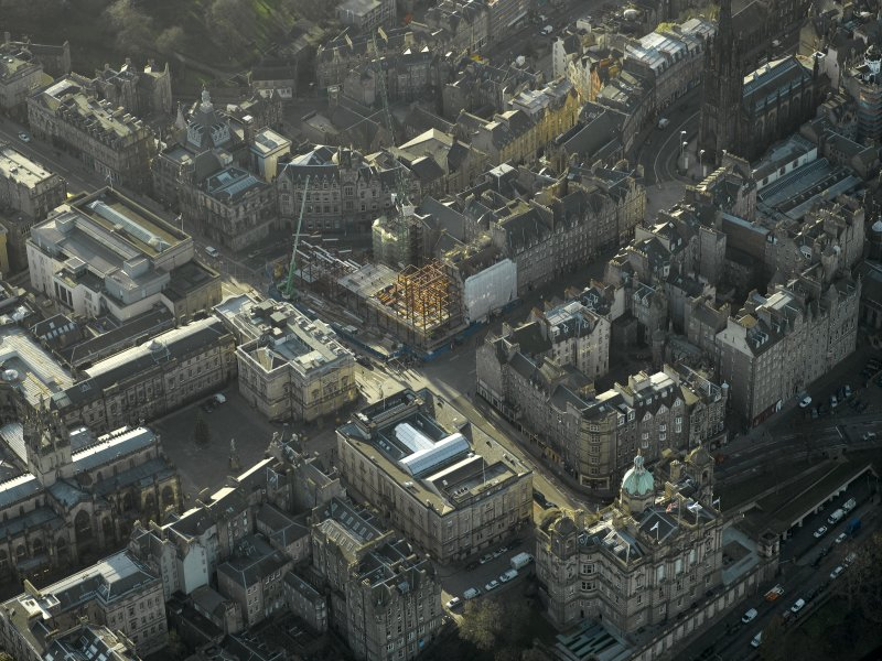 Oblique aerial view centred on new construction work at the junction of High Street and George IV Bridge, taken from the NE.