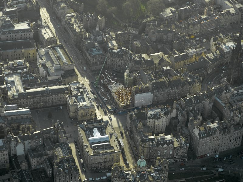Oblique aerial view centred on new construction work at the junction of High Street and George IV Bridge, taken from the N.