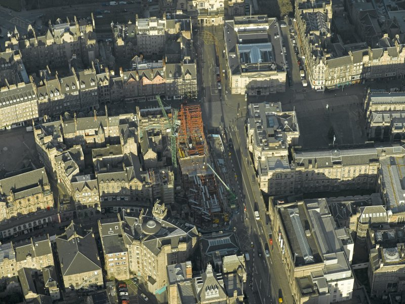 Oblique aerial view centred on new construction work at the junction of High Street and George IV Bridge, taken from the S.