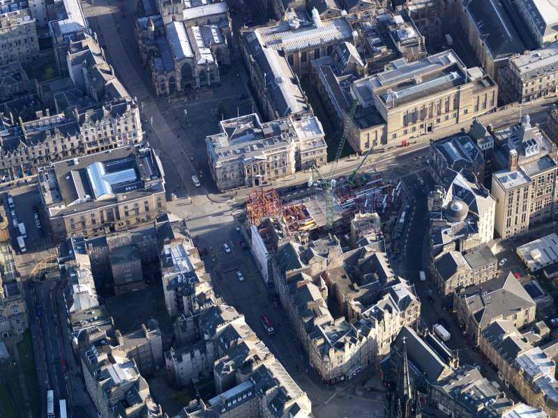 Oblique aerial view centred on new construction work at the junction of High Street and George IV Bridge, taken from the W.