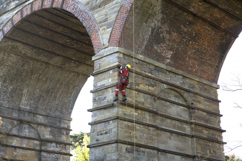 Detail of Newbattle Viaduct from NE showing drill operator abseiling whilst test drilling lower pier of viaduct