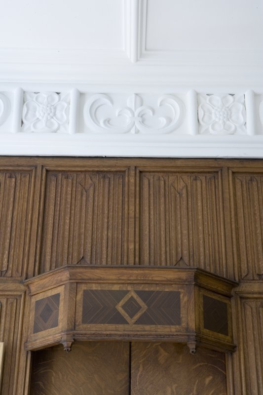 Interior. Ground floor. South west room. Detail of panelling and cornice.