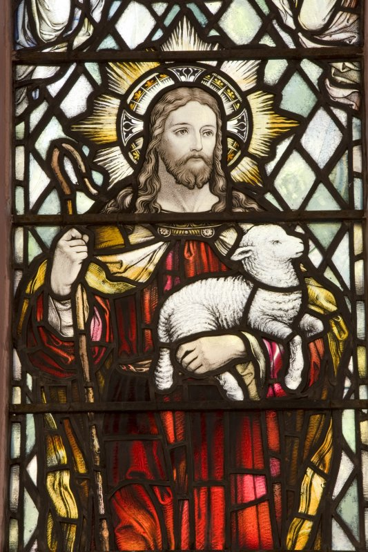 Interior. N side stained glass window. Detail of The Good Shepherd