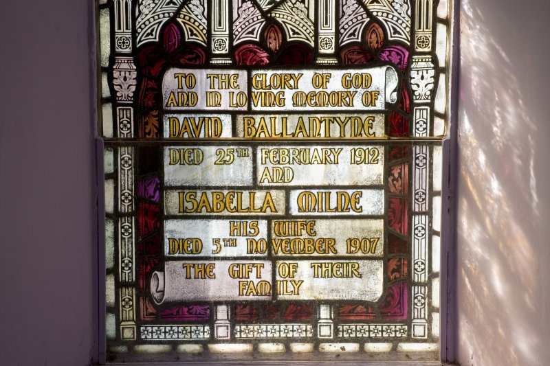 Interior. Upper hall. David Ballantyne and Isabella Milne memorial stained glass window. Detail of  memorial plaque