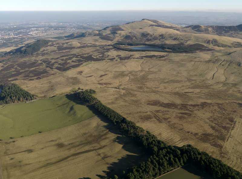 General oblique aerial view centred on the remains of rig and furrow cultivation on the NW-facing slopes of the Petlands, taken from the W.