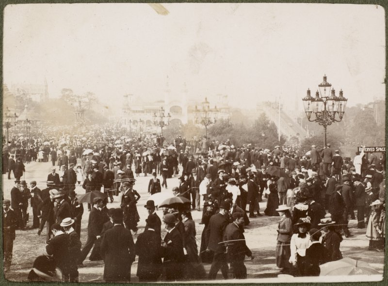 View of crowds with exhibition buildings at Kelvingrove Park faintly in the background at the International Exhibition in Glasgow 1901.