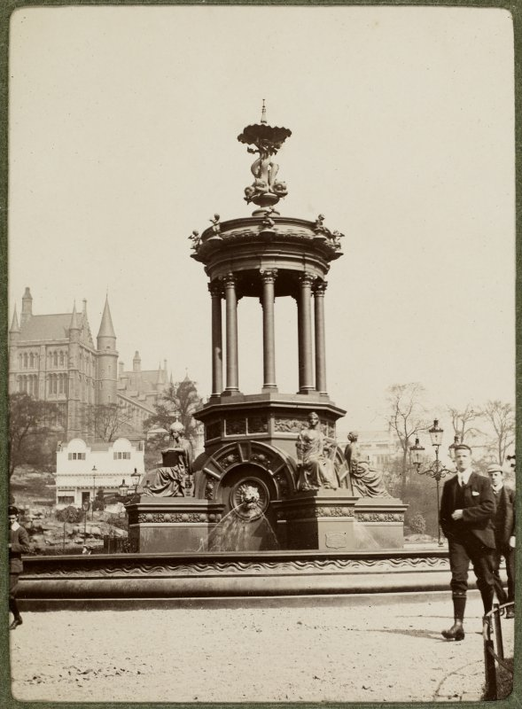View of fountain. Titled: 'Fountain in Kelvingrove Park and University in background'