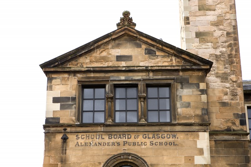 E gable, detail of triple window, pediment and lettering