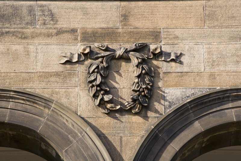 Detail of wreath decoration on E front