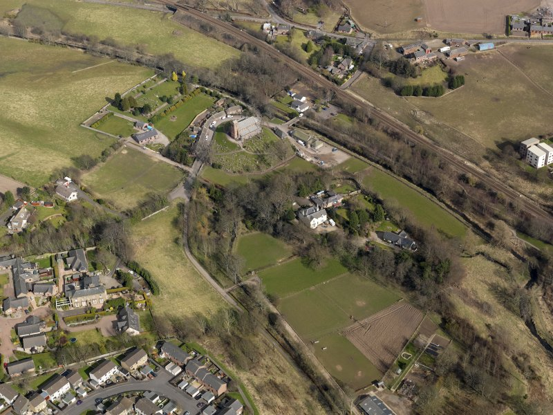 Oblique aerial view centred on the church and manse, taken from the SSW.