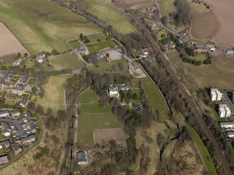 Oblique aerial view centred on the church and manse, taken from the S.