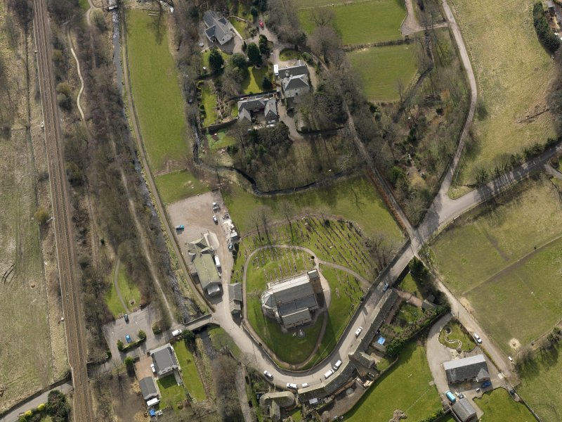 Oblique aerial view centred on the church and manse, taken from the N.