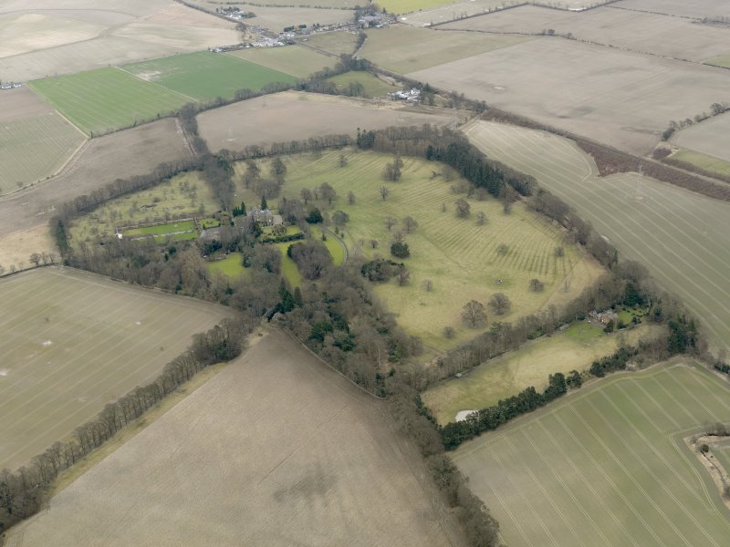 General oblique aerial view centred on the tower house with the remains of the rig and furrow adjacent, taken from the NW.