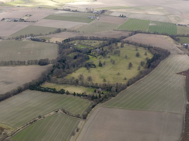 General oblique aerial view centred on the tower house with the remains of the rig and furrow adjacent, taken from the SW.