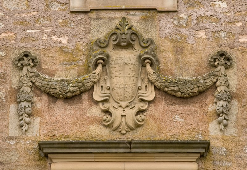 Detail of armourial panel over original entrance