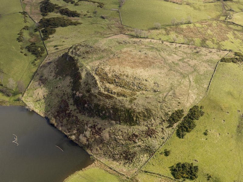 Oblique aerial view centred on the remains of a fort, taken from the W.