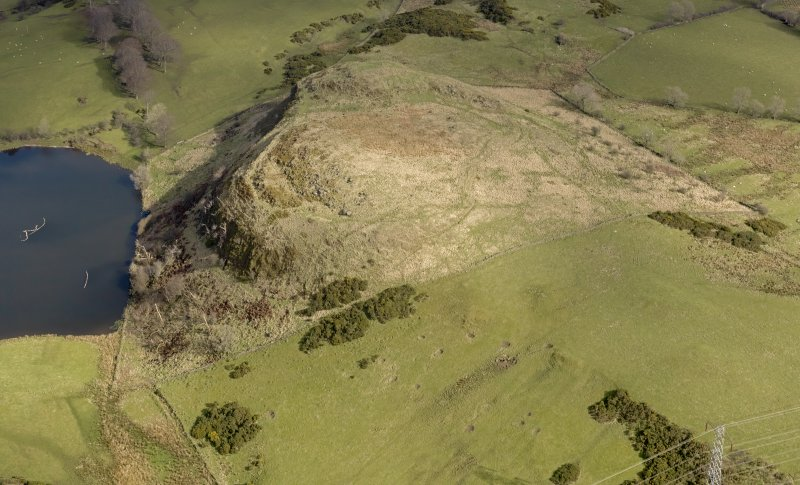 Oblique aerial view centred on the remains of a fort, taken from the WSW.