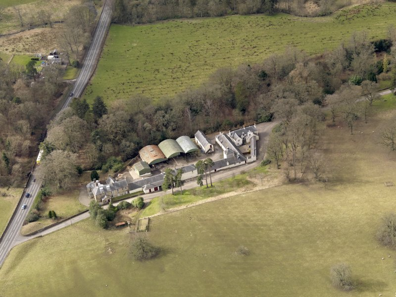 Oblique aerial view centred on the Mains Farmstead, taken from the SE.
