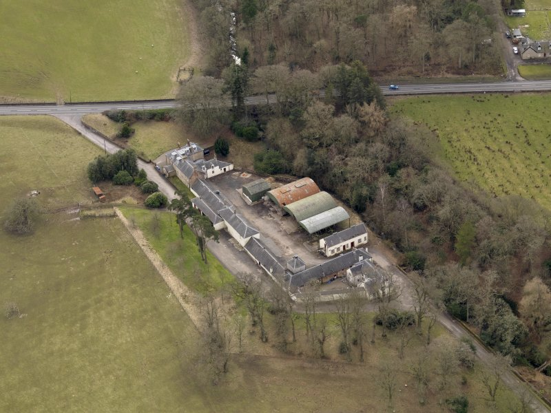 Oblique aerial view centred on the Mains Farmstead, taken from the N.
