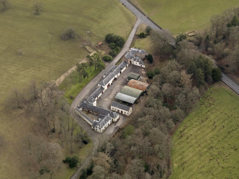 Oblique aerial view centred on the Mains Farmstead, taken from the NW.