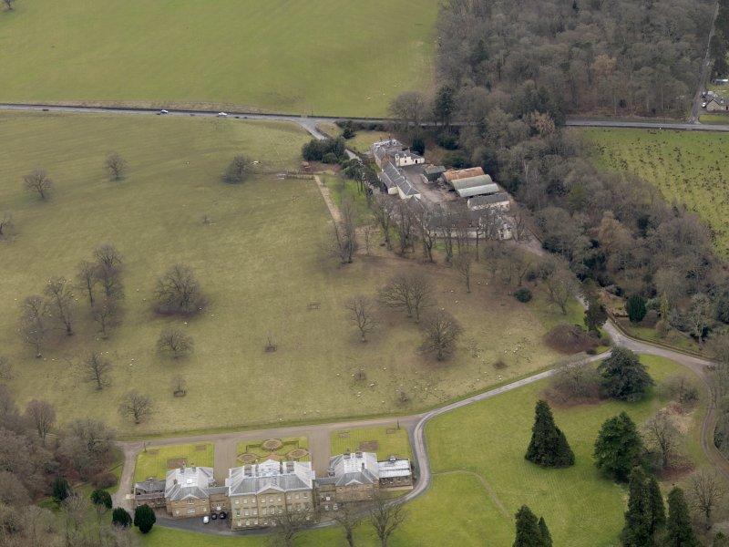 Oblique aerial view centred on the House with the farmstead adjacent, taken from the N.