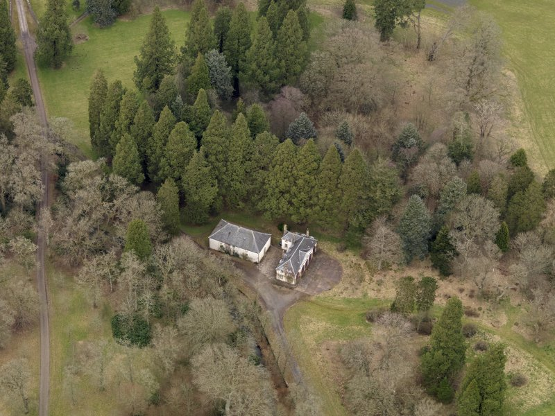 Oblique aerial view centred on the coach house and stables, taken from the S.