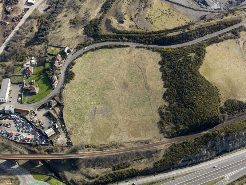 Oblique aerial view centered on the former golf course with the railway viaduct adjacent, taken from the W.
