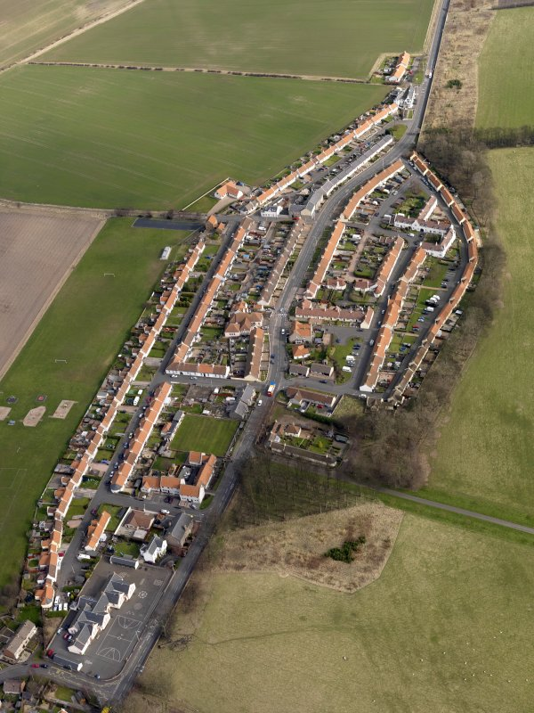 Oblique aerial view centred on the village, taken from the SW.