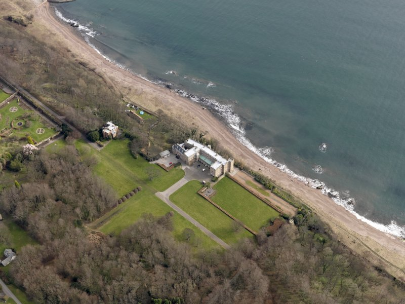 Oblique aerial view centred on the tower-house with the house adjacent, taken from the W.