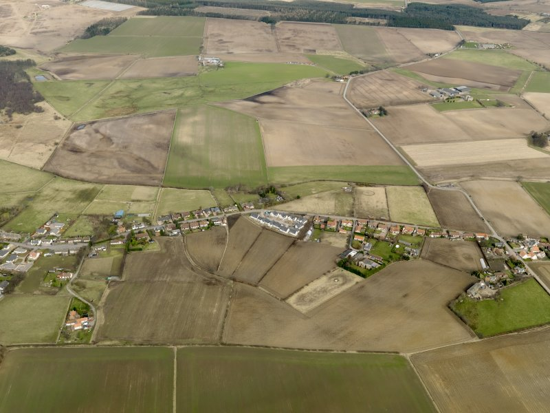 General oblique aerial view centred on the village, taken from the S.