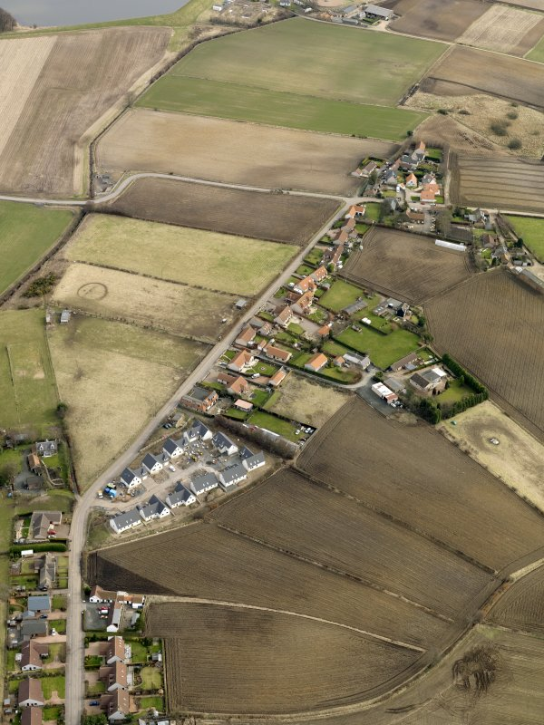 General oblique aerial view centred on the east end of the village, taken from the W.