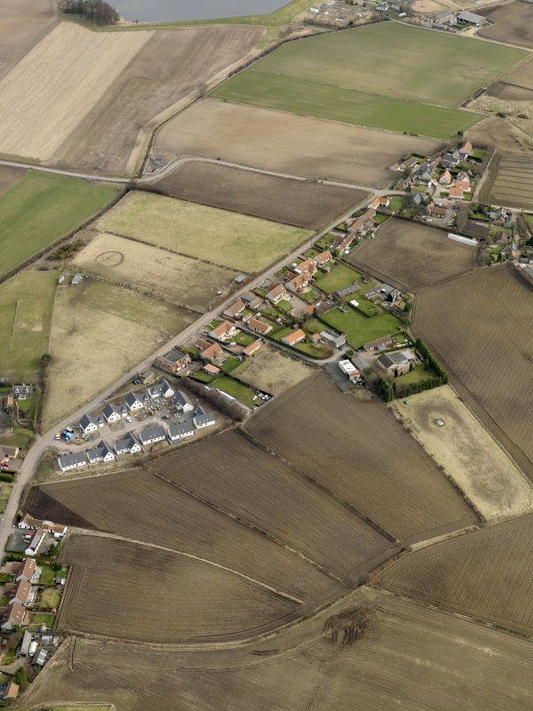 Oblique aerial view centred on the east end of the village, taken from the SW.