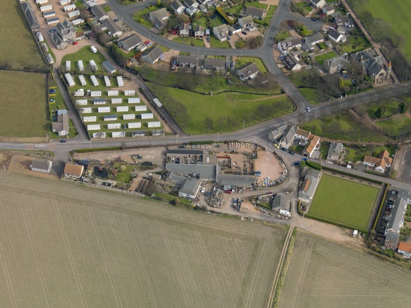 Oblique aerial view centred on the garden centre with the bowling green adjacent, taken from the WSW.
