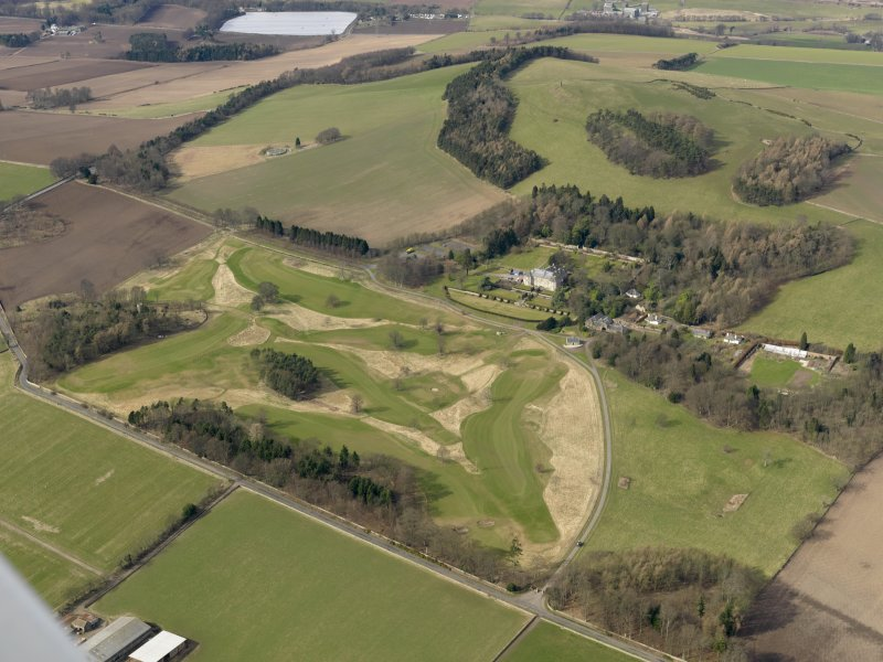 General oblique aerial view centred on the golf course with the country house, dovecot, stable, lodge, and cottage adjacent, taken from the SE.