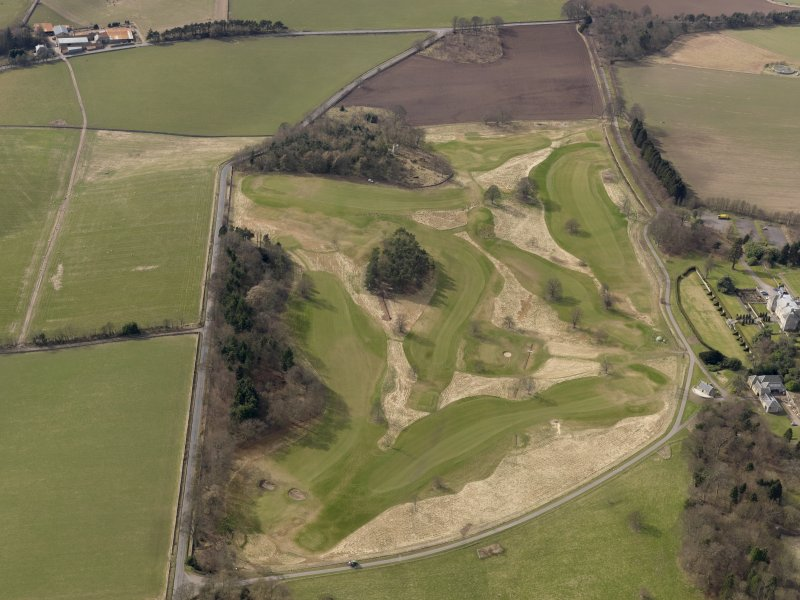 Oblique aerial view centred on the golf course with the country house, dovecot, stable and lodge adjacent, taken from the ENE.