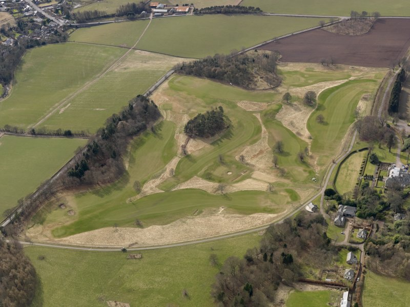 Oblique aerial view centred on the golf course with the country house, dovecot, lodge, cottage and stable adjacent, taken from the NE.