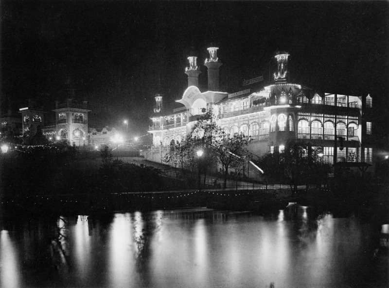 Digital copy of night-time photograph of illuminated restaurant building at the Glasgow International Exhibition in 1901.
