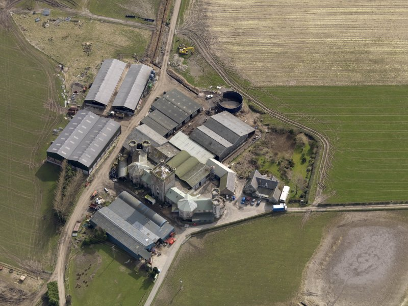 Oblique aerial view centred on the Home Farm, taken from the NW.
