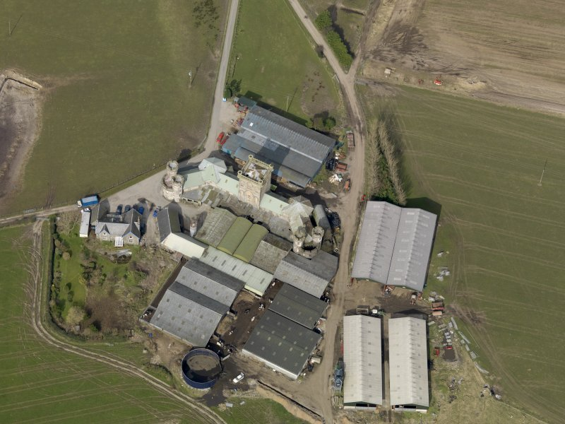 Oblique aerial view centred on the Home Farm, taken from the SE.
