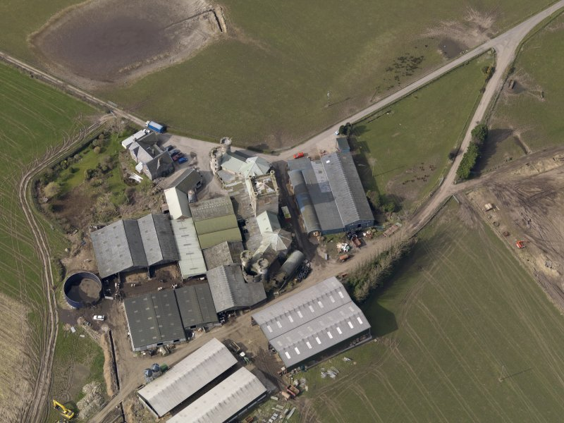 Oblique aerial view centred on the Home Farm, taken from the ESE.