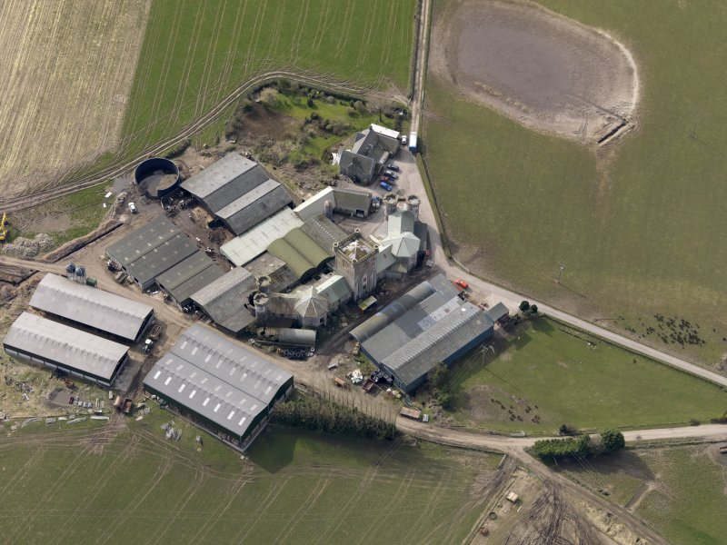Oblique aerial view centred on the Home Farm, taken from the NE.
