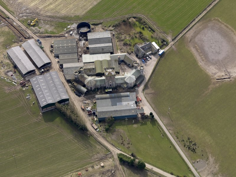 Oblique aerial view centred on the Home Farm, taken from the NNE.