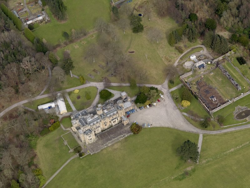 Oblique aerial view centred on the house with the walled garden adjacent, taken from the SW.