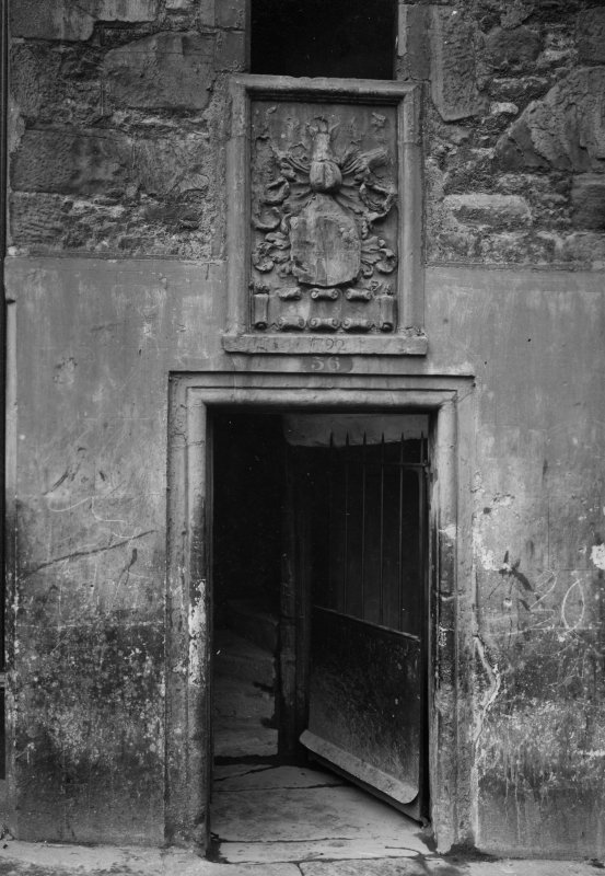 EPS/4/1  Photograph, detail of No 36 doorway with text; 'Candlemaker Row - Old doorway, with arms of Candlemakers' Edinburgh Photographic Society Survey of Edinburgh and District, Ward XIV George Square