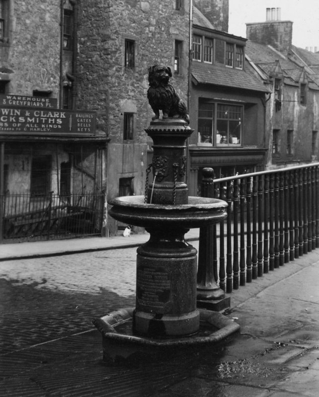 """Greyfriars Bobby"" statue with Candlemaker Row behind.  Edinburgh Photographic Society Survey of Edinburgh and District, Ward XIV George Square"
